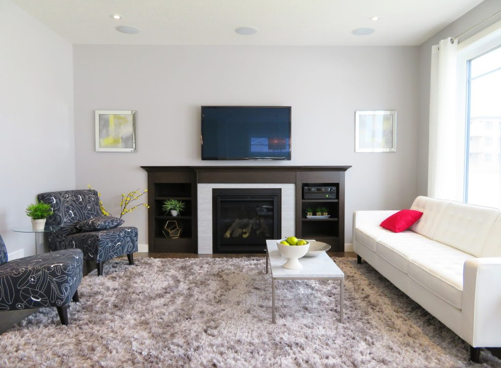 TV mounted above mantel in living room