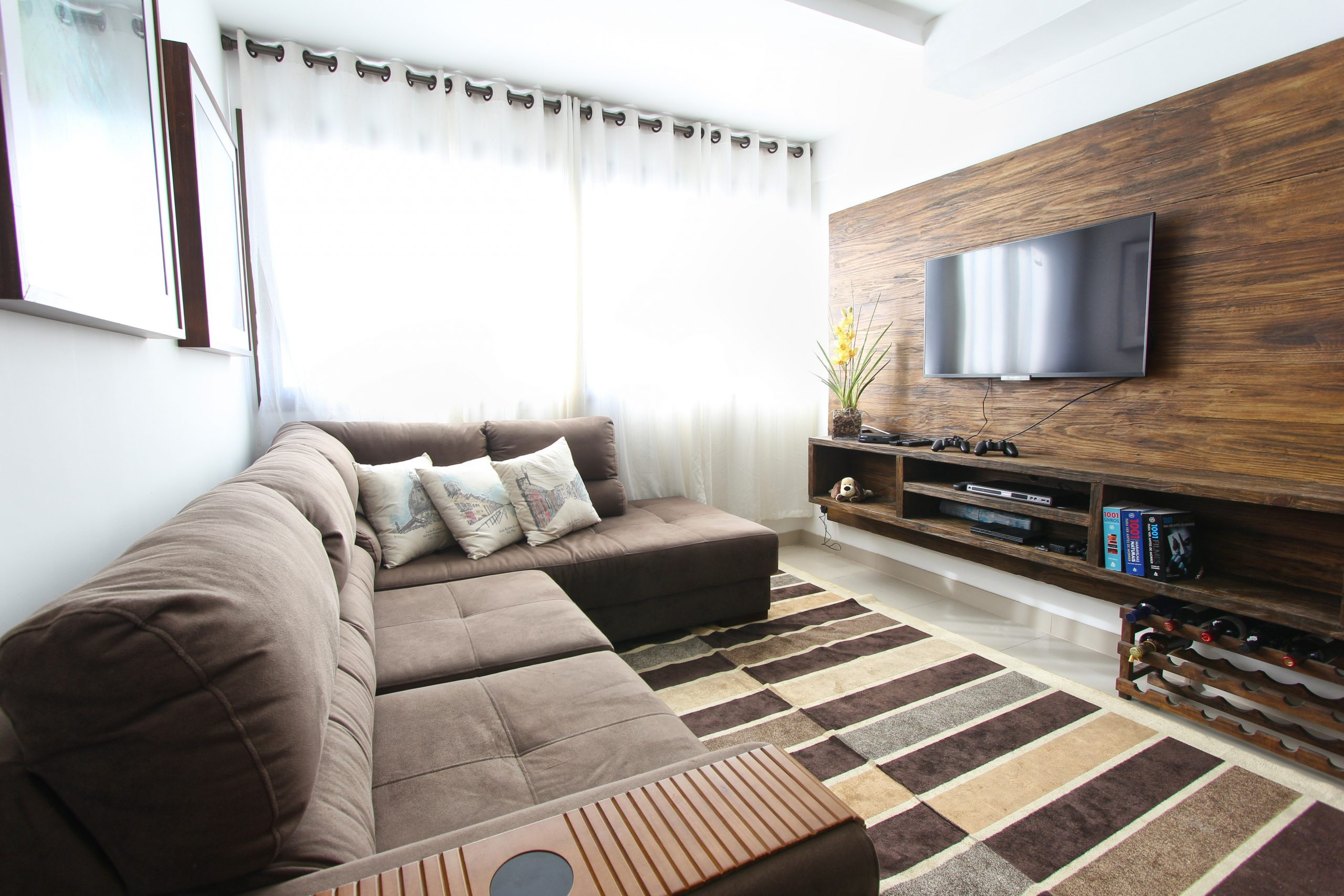 Flatscreen TV mounted above entertainment center cables concealed
